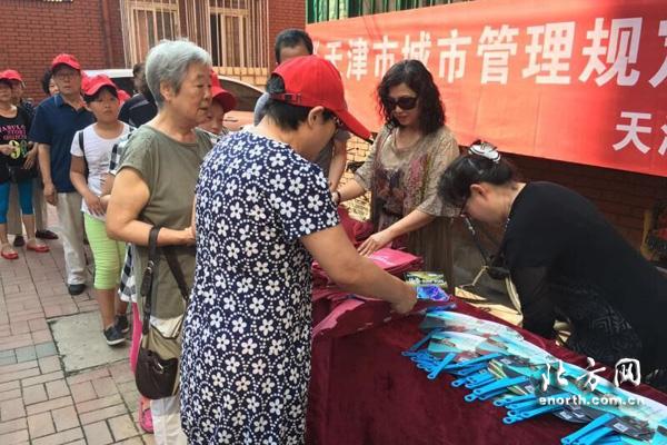 宁夏路社区迎全运普及《天津市城市管理规定》金品轩